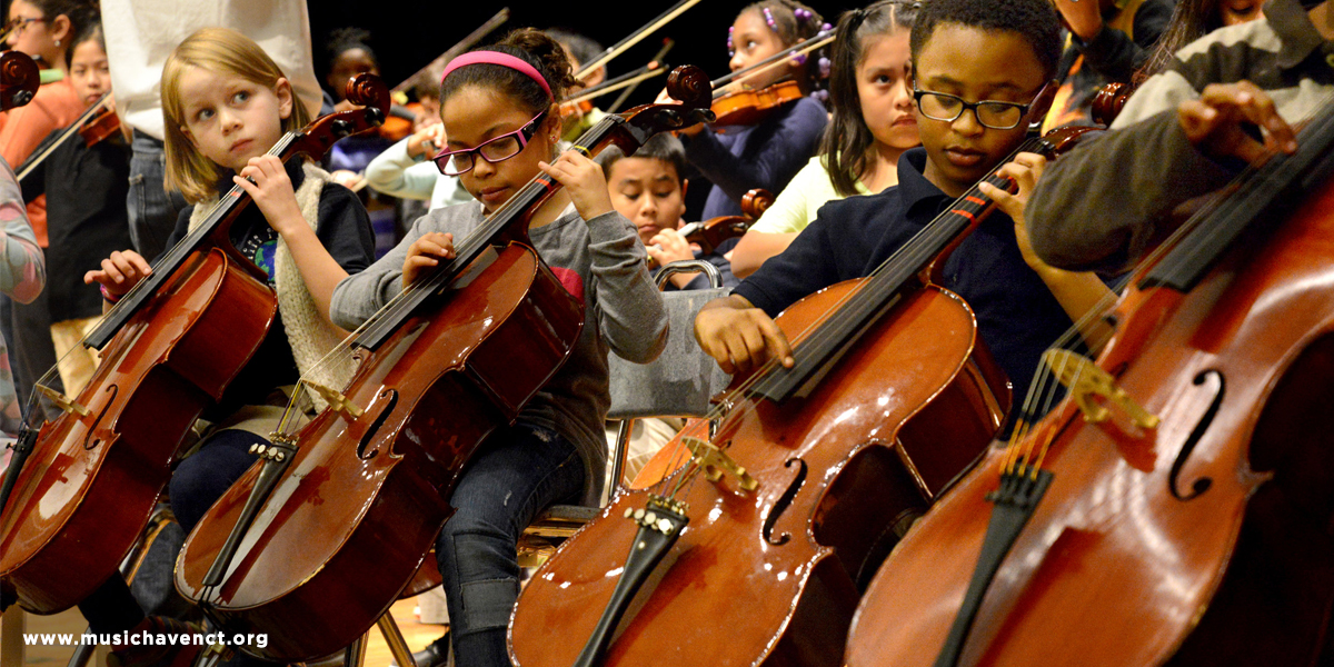 Children playing cellos.