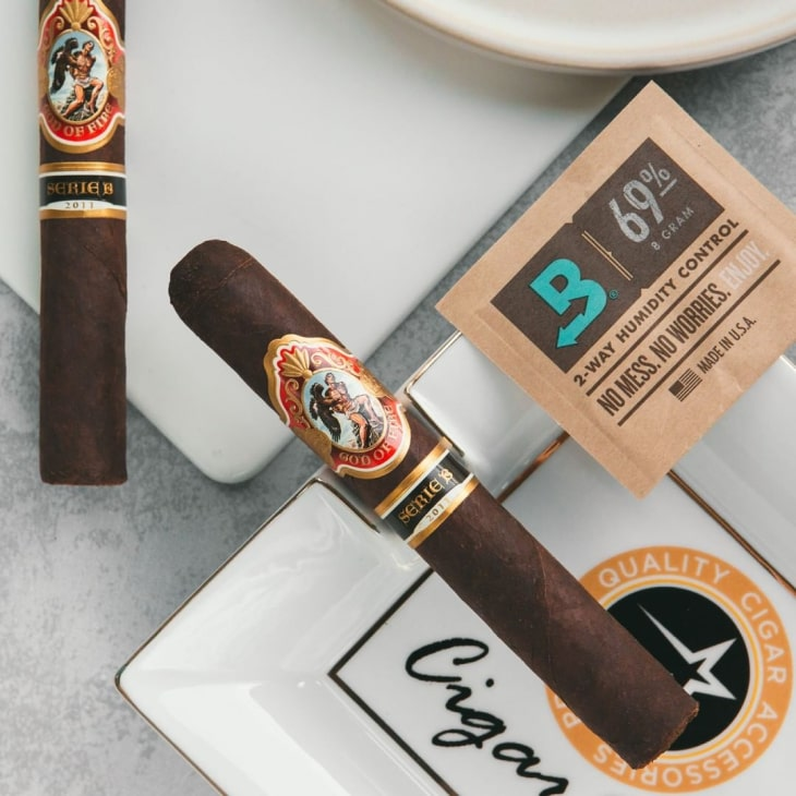 Cigars and a Boveda pack sitting on an ashtray.