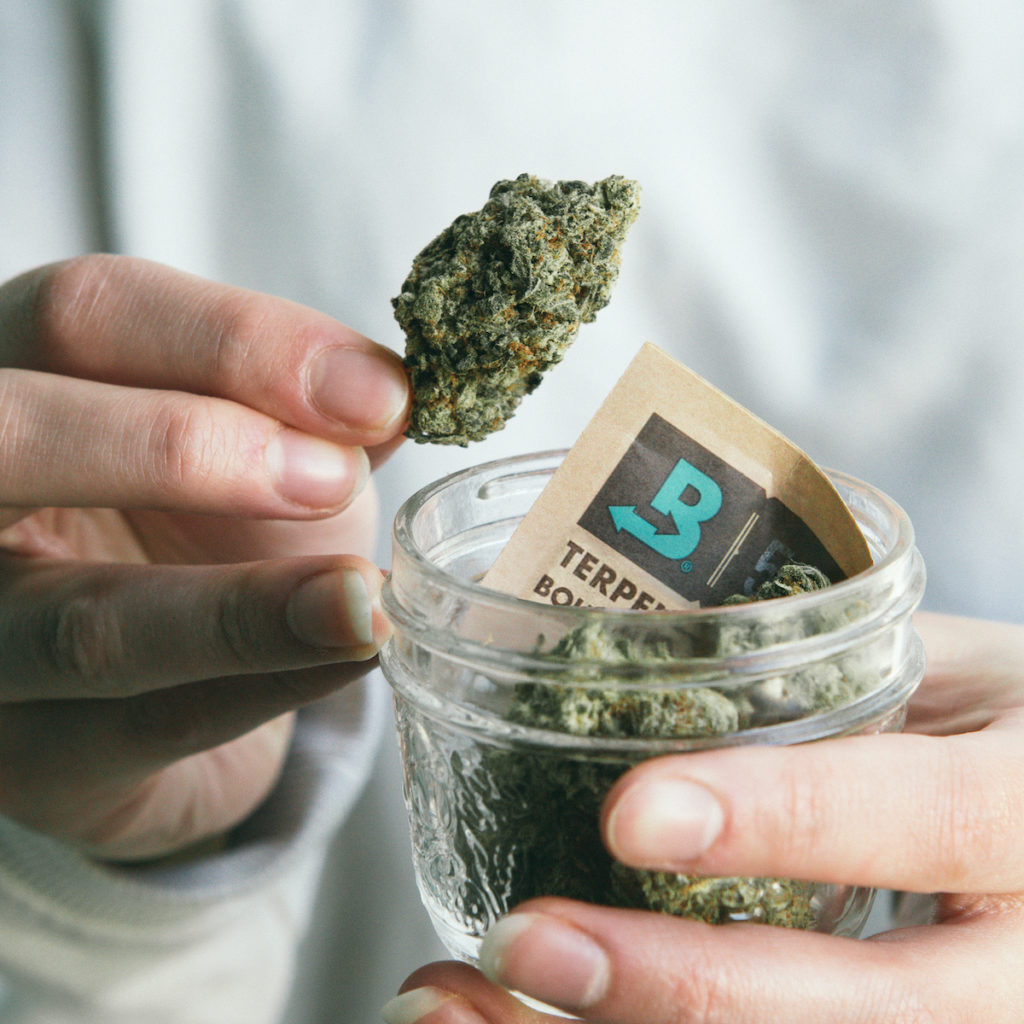 Jar of cannabis flower with Boveda pack.