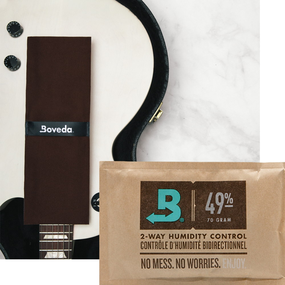 Boveda 49% RH Size 70 and a guitar.