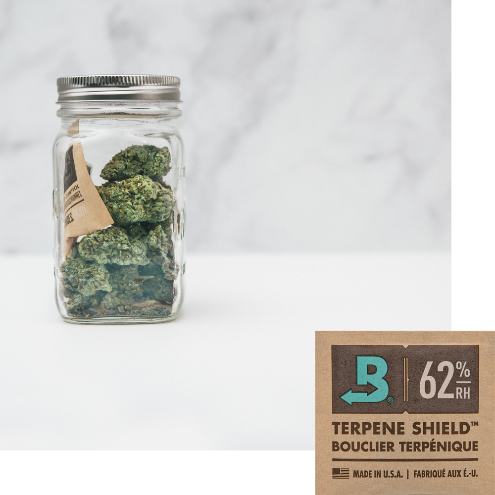 Boveda size 8 and a jar of flower protected by a Boveda pack.