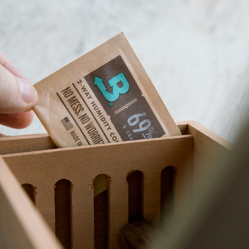Boveda pack being placed into a humidor