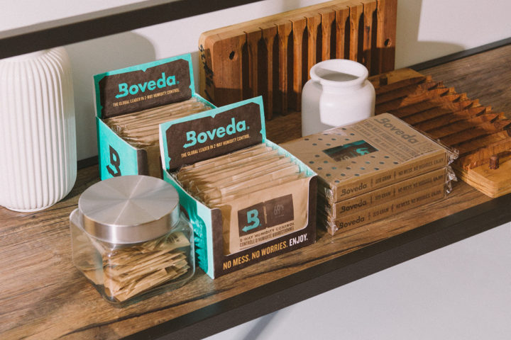 Selection of various Boveda packs on a shelf.