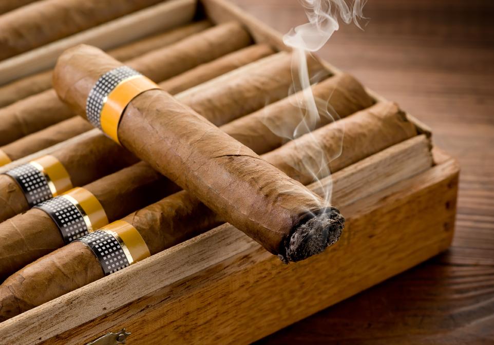 lit cigar on box