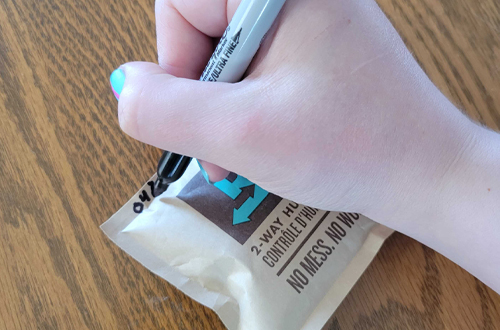 Write date on the edge of new Boveda with a Sharpie.